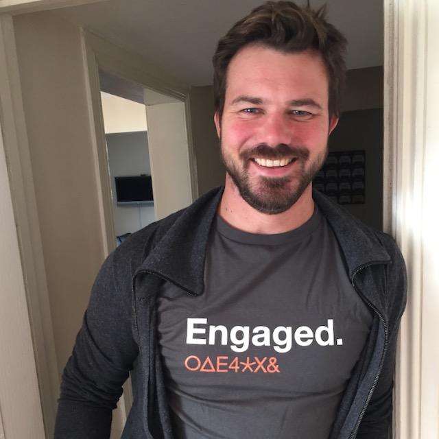 Scott wearing a t-shirt that says